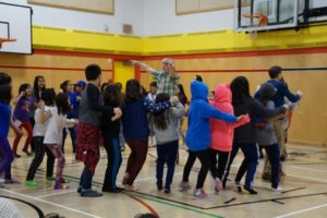 Gordon Stobbe leading the students in a dance.